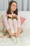 Mulher nova bonita com tulips Foto de Stock Royalty Free