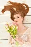 Mulher nova bonita com tulips Imagens de Stock