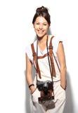 Mulher nova bonita com uma câmera Fotos de Stock