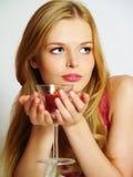 Mulher nova bonita com vela no vidro Imagens de Stock Royalty Free