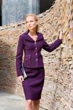Mulher nova bonita em um terno imagens de stock