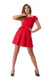 Mulher nova bonita em um vestido vermelho fotos de stock