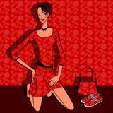 Mulher nova bonita em um vestido vermelho Imagens de Stock