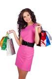Mulher nova bonita feliz com sacos de compra Foto de Stock Royalty Free