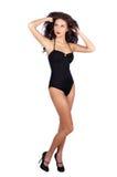Mulher nova bonita no biquini preto Imagens de Stock