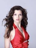 Mulher nova bonita no vermelho Imagens de Stock Royalty Free