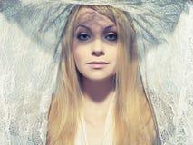 Mulher nova bonita sob um véu Imagens de Stock Royalty Free