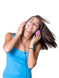 Mulher nova bonito com os auscultadores que dançam na música Imagens de Stock