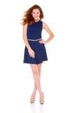 Mulher nova bonito no vestido do azul de marinha no branco Imagens de Stock