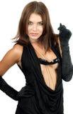 Mulher nova brincalhão em dres pretos foto de stock