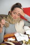A mulher nova com alta temperatura é doente Imagens de Stock Royalty Free