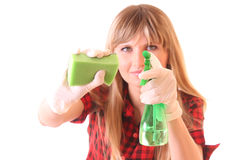 Mulher nova com as fontes de limpeza isoladas Fotografia de Stock