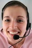 Mulher nova com auriculares Fotografia de Stock Royalty Free