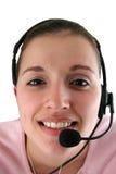 Mulher nova com auriculares Fotos de Stock Royalty Free