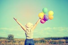 Mulher nova com balões coloridos Foto de Stock Royalty Free
