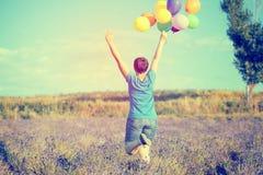 Mulher nova com balões coloridos Imagem de Stock