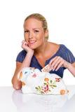 Mulher nova com banco piggy Foto de Stock Royalty Free