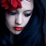 Mulher nova com bordos vermelhos Imagem de Stock Royalty Free