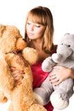 Mulher nova com brinquedos Fotografia de Stock