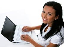 Mulher nova com computadores Foto de Stock Royalty Free