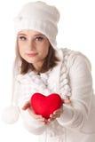 Mulher nova com coração vermelho nas mãos Fotografia de Stock