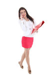 Mulher nova com dobrador e telefone Fotografia de Stock