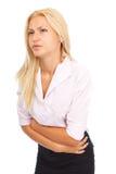 Mulher nova com dor abdominal Fotos de Stock
