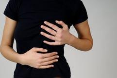 Mulher nova com dor dos peitos Imagem de Stock