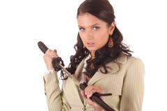 Mulher nova com espada japonesa - katana imagens de stock