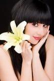 Mulher nova com flor imagens de stock royalty free