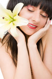 Mulher nova com flor Foto de Stock