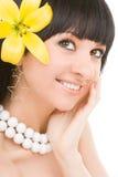 Mulher nova com flor Imagem de Stock Royalty Free
