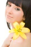 Mulher nova com flor Foto de Stock Royalty Free
