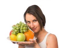 Mulher nova com fruta fresca fotos de stock royalty free