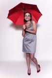 Mulher nova com guarda-chuva foto de stock royalty free