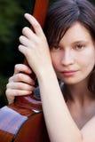 Mulher nova com guitarra Imagem de Stock Royalty Free