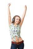 Mulher nova com mãos de aumentação dos headhpones foto de stock
