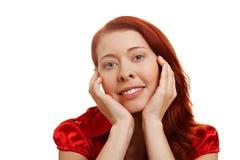 Mulher nova com mãos em seu queixo Fotografia de Stock Royalty Free