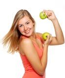 Mulher nova com maçãs fotografia de stock