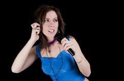 Mulher nova com microfone Imagem de Stock