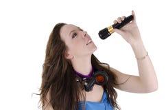 Mulher nova com microfone Imagens de Stock Royalty Free