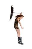 Mulher nova com o guarda-chuva fundido pelo vento. Imagem de Stock Royalty Free