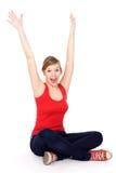 Mulher nova com os braços levantados Foto de Stock Royalty Free