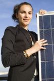 Mulher nova com painel solar Imagem de Stock