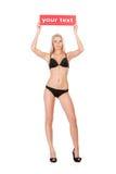 Mulher nova com placa em branco Foto de Stock Royalty Free
