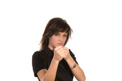 Mulher nova com punhos levantados Fotografia de Stock