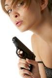 Mulher nova com revólver Imagens de Stock