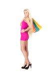 Mulher nova com sacos de compra Foto de Stock Royalty Free
