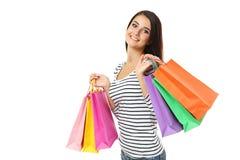 Mulher nova com sacos de compra Fotografia de Stock