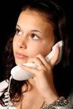 Mulher nova com telefone Imagens de Stock